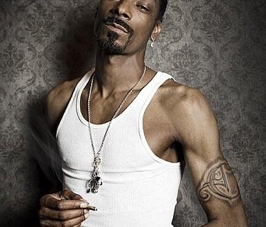 Snoop-Dogg left Bicep Tattoo