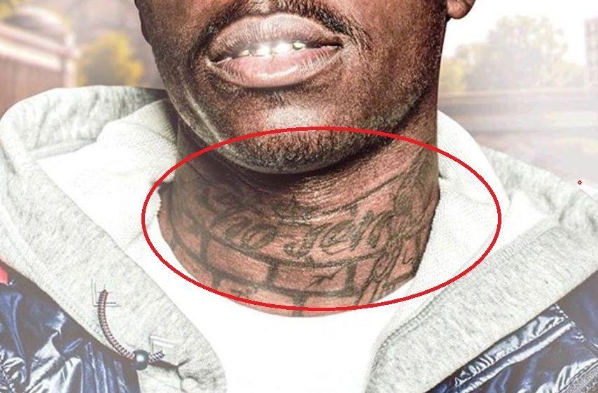 brick like design on neck- Kodak black tattoo