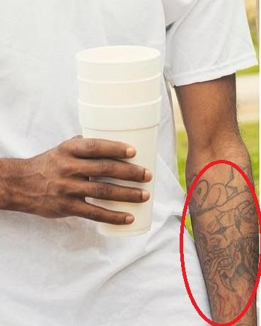 skull with tongue on his left forearm -21 savage tattoos
