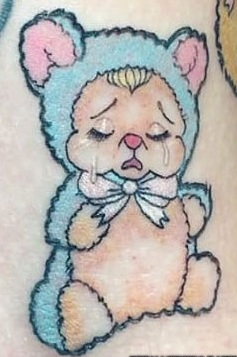 Melanie-Martinez-Crying Teddy Bear Tattoo