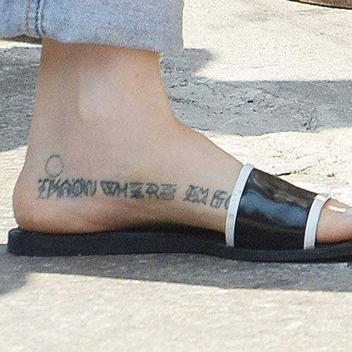 Zosia-Mamet-writing-foot-tattoo