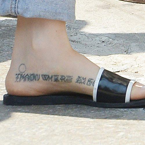 Zosia-Mamet-writing-foot-tattoo