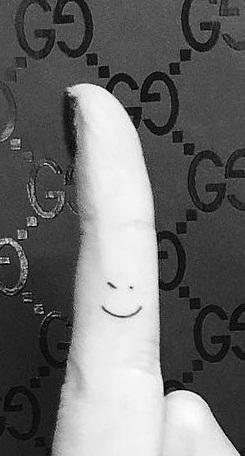 ashley benson smiley face tattoo