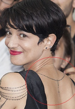 asia argento cross necklace tattoo