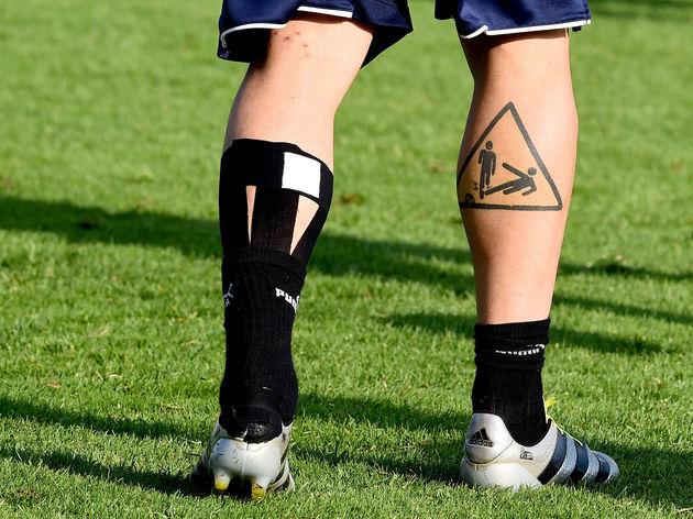 Daniel D Rosie right back leg tattoo