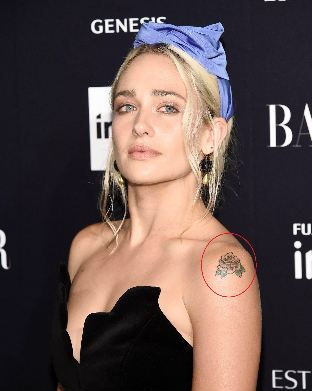 Jemima kirke left shoulder rose tattoo