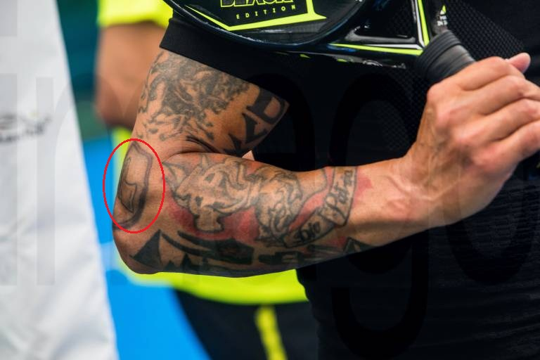 Paolo right arm logo tattoo
