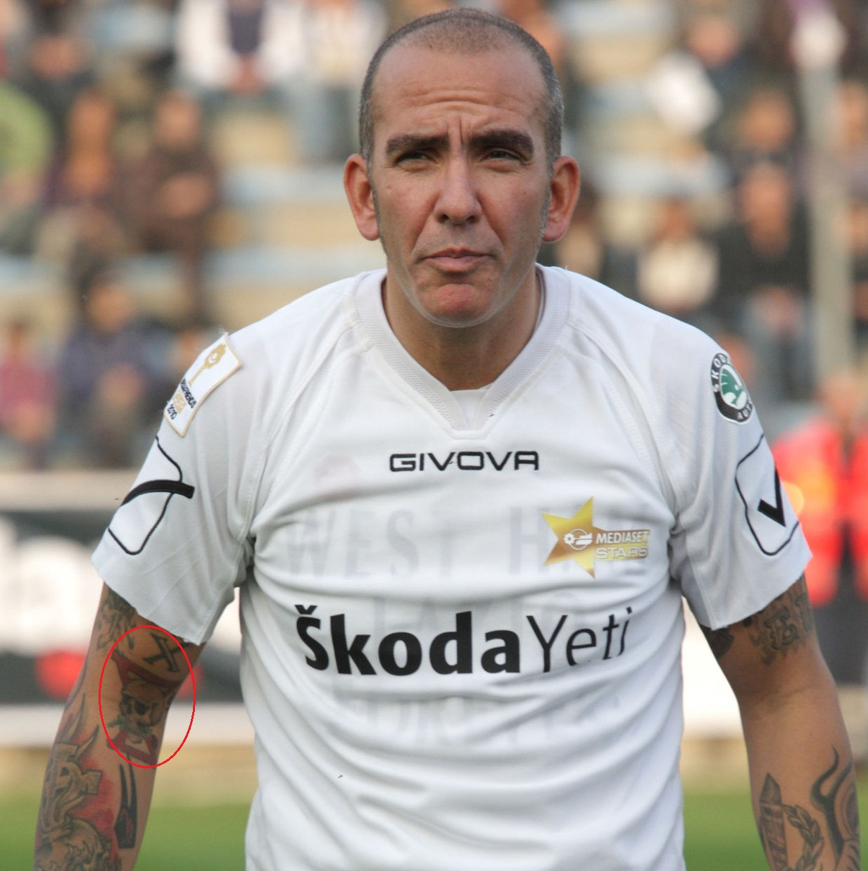 Paolo Di Canio right arm skull tattoo