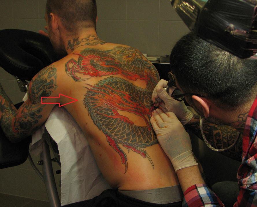 Raul Meireles back tattoo dragon