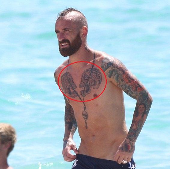 Raul Meireles chest skull tattoo