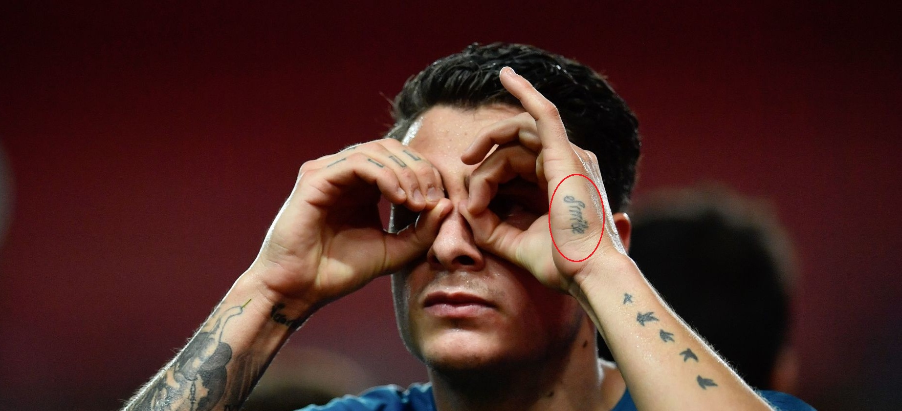 Jose Gimenez Left Hand Smile Tattoo