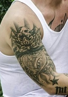 J Balvin Right Arm Tattoo