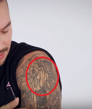 J Balvin Woman holding Weights Tattoo