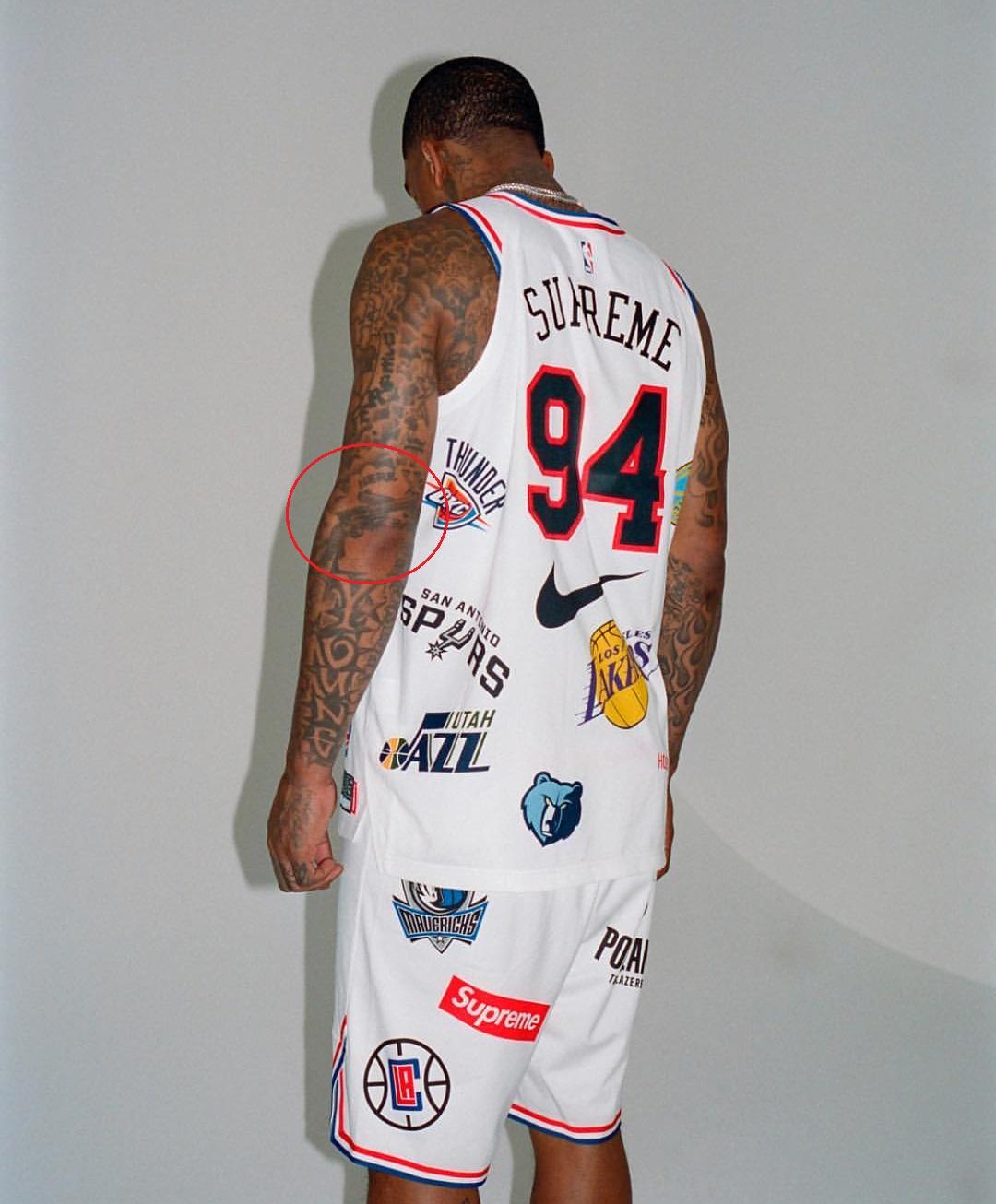 J.R. Smith Left Arm Gun Tattoo