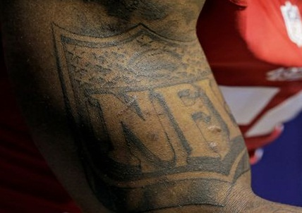 Navarro Bowman Left Arm Nfl flag Tattoo