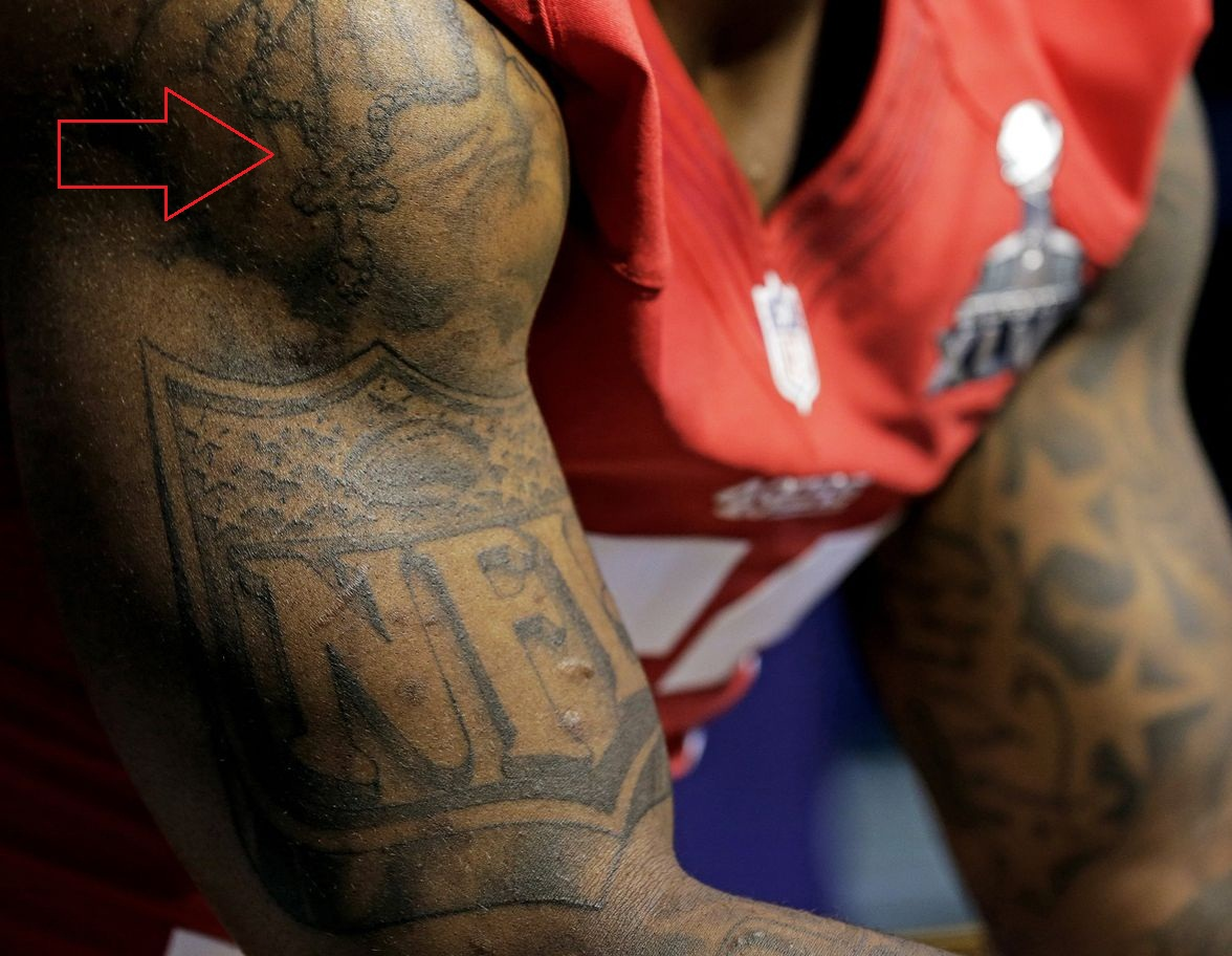 Navarro Bowman Shoulder Cross Tattoo