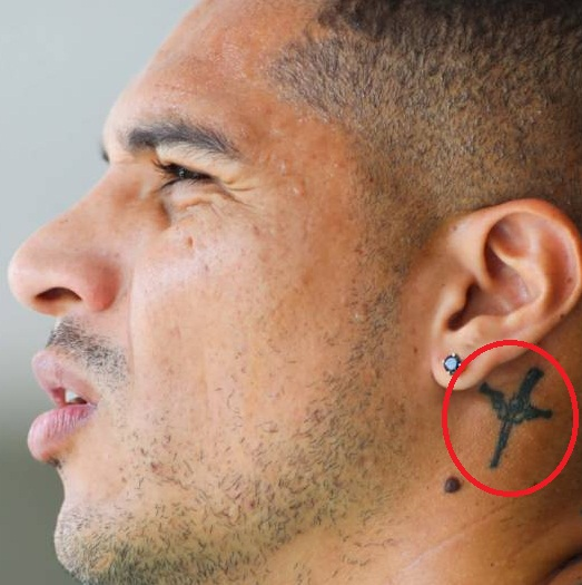 Paolo Guerrero Left Ear Gun Tattoo