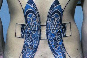 Piscean lower back tattoo