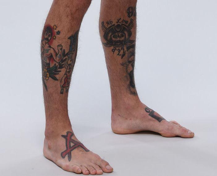 Cody leg tattoos