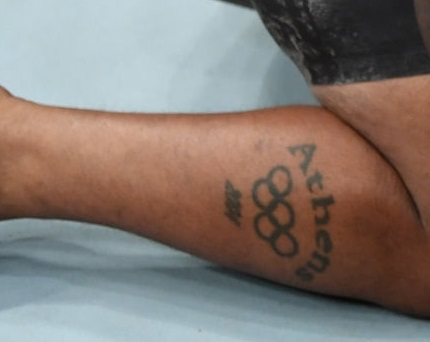 Daniel Cormier Right Leg Tattoo