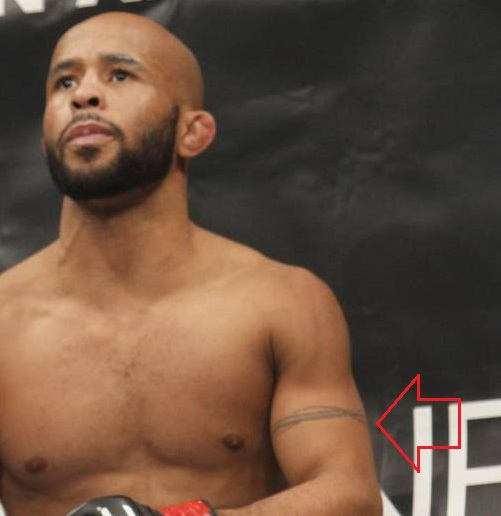 Demetrious Johnson Left arm Band Tattoo
