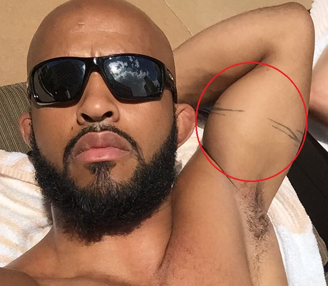 Demetrious Johnson Left arm Tattoo.jpg