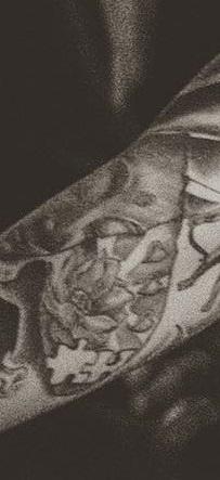 Joanne Calderwood Right Arm Puzzle Piece Tattoo
