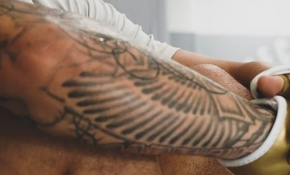 Max Holloway Wings Tattoo