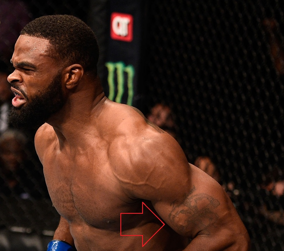 Tyron Woodley Left Arm Bicep Tattoo