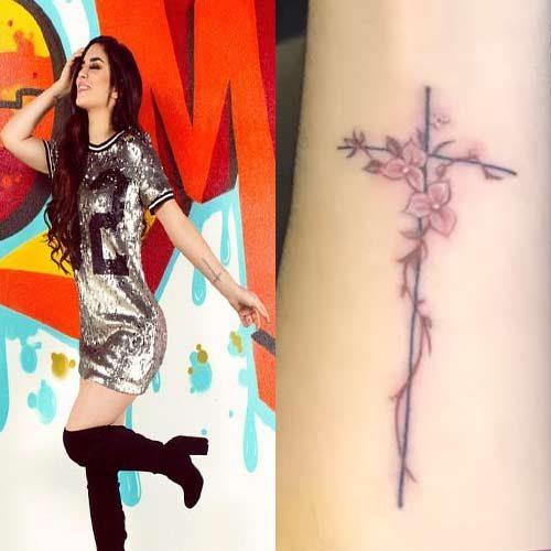 kimberly loaiza cross flowers arm tattoo