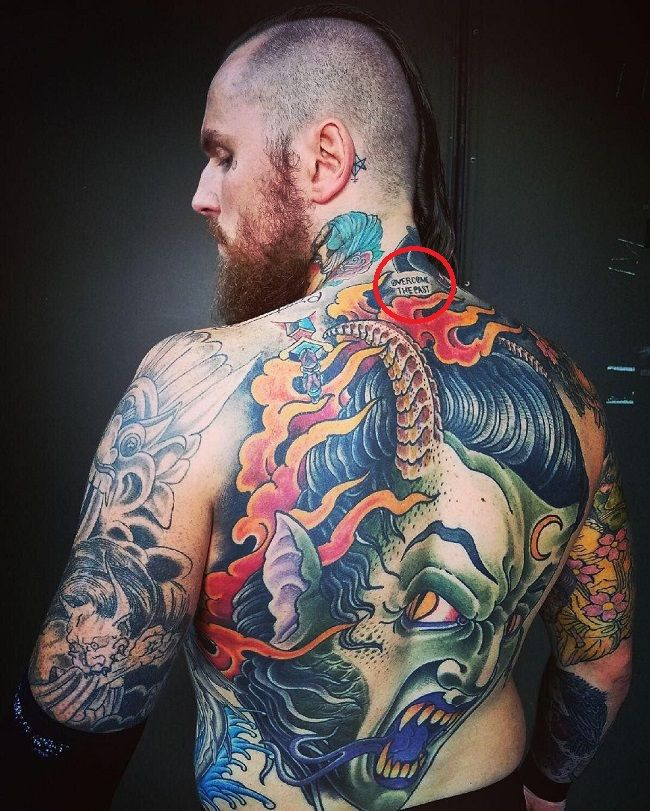 Aleister Black-OVERCOME THE PAST Tattoo