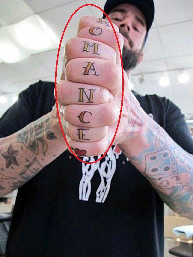 CM Punk-roamnce tattoo