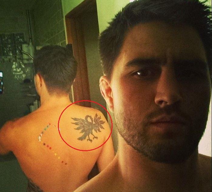 Carlos Condit bird tattoo
