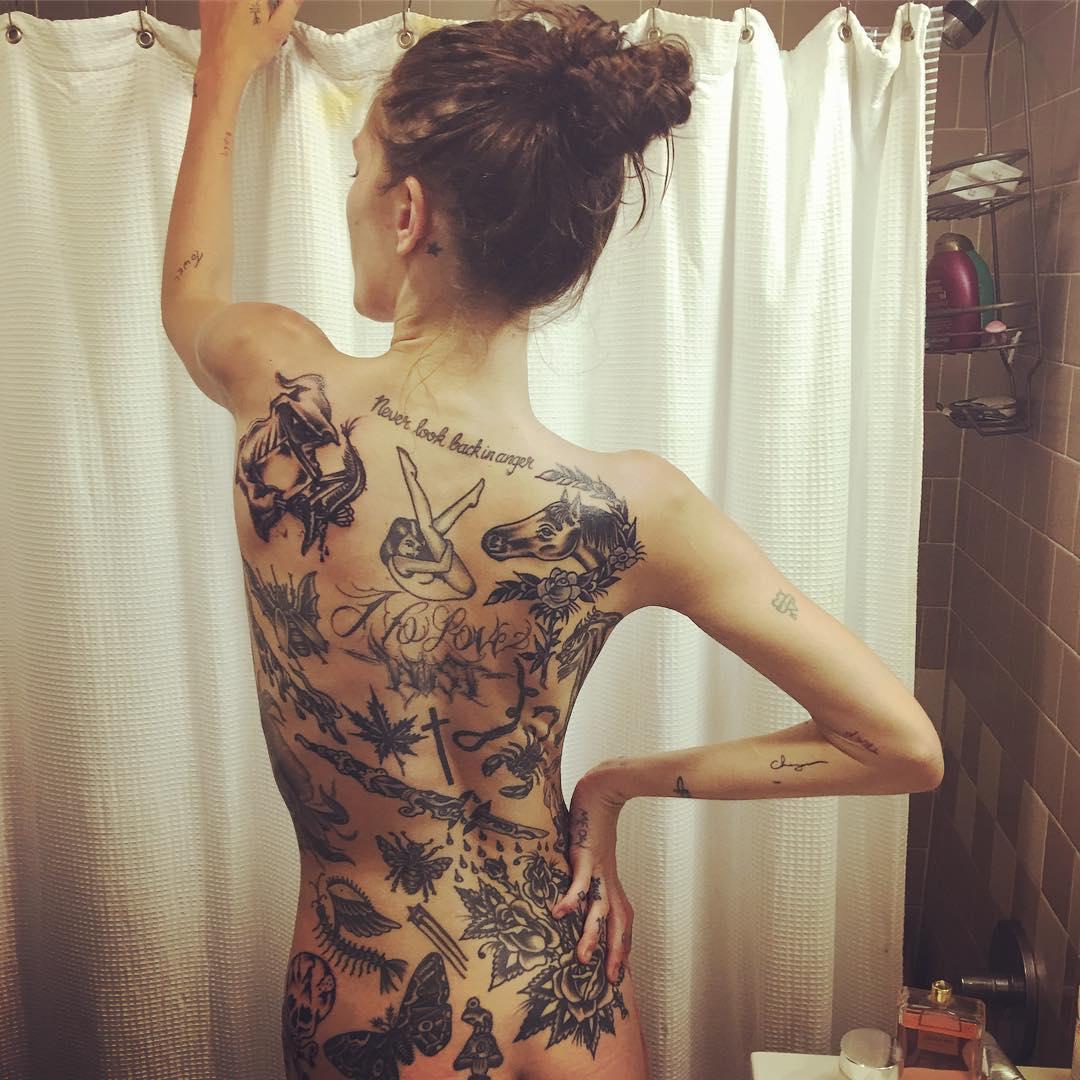 Catherine McNeil Back Tattoos