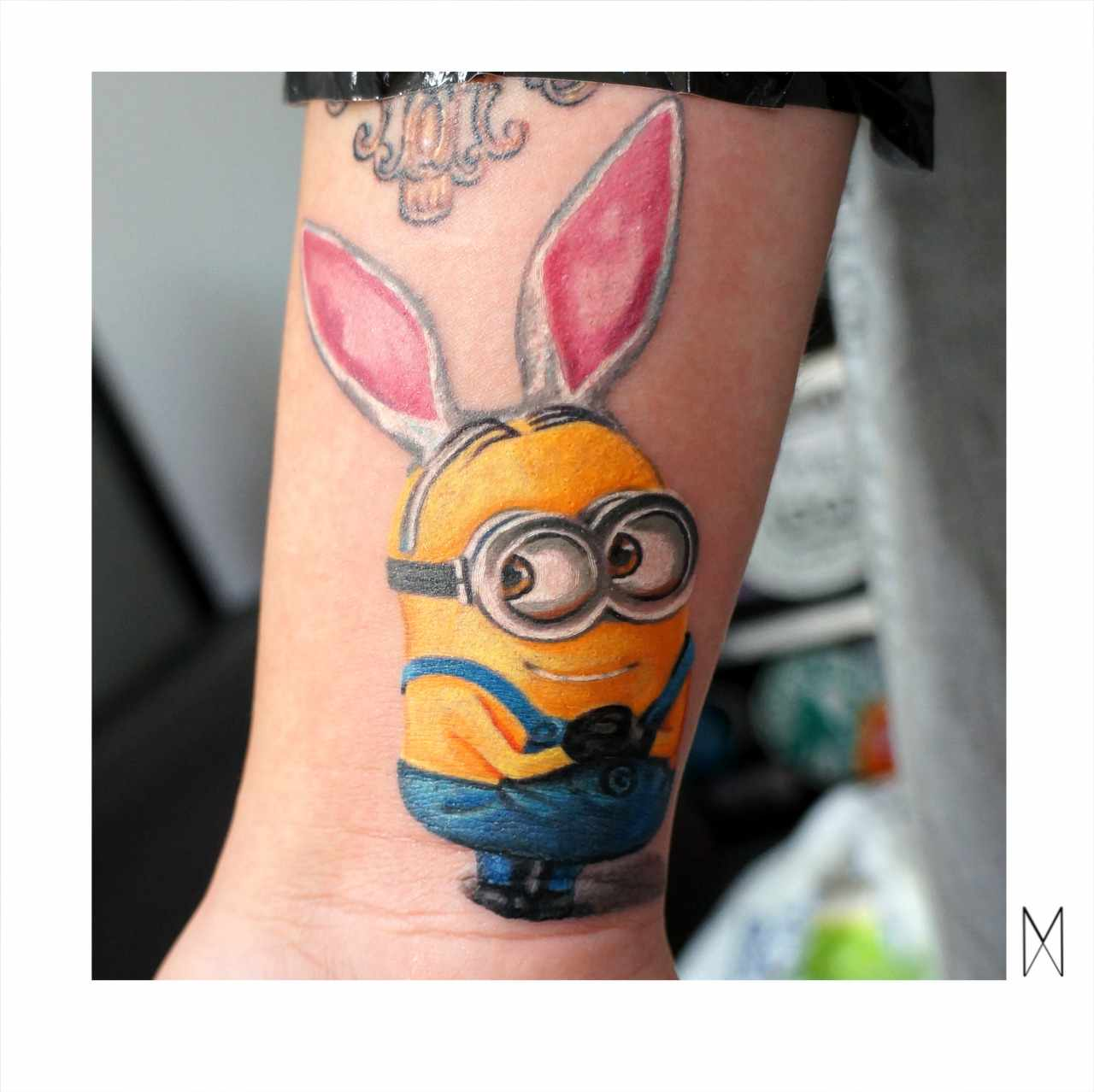 Colorful Minion With Rabbit Ears Tattoo Design