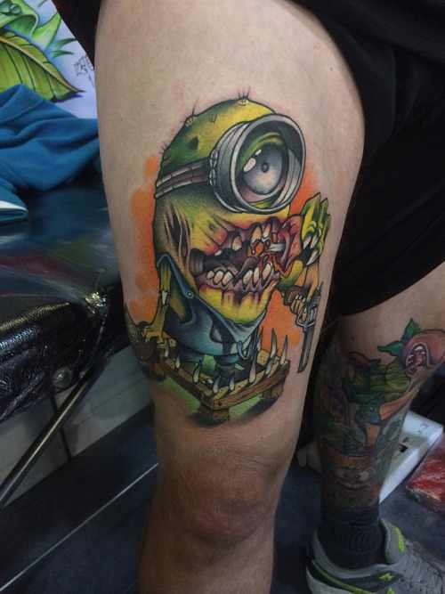 Colorful Zombie Minion Tattoo On Thigh
