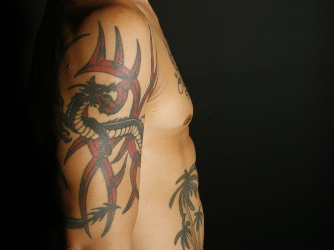 Cub Swanson Dragon with Large arm Tattoo
