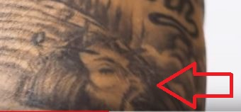 Dustin Poirier Jesus Portrait Tattoo