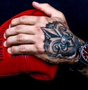 Dustin Poirier Left Hand Tattoo