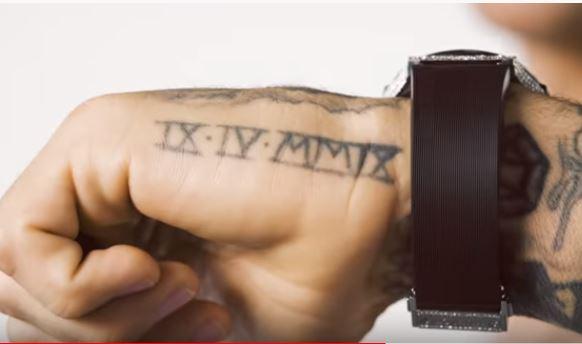 Dustin Poirier Roman Numerals Tattoo