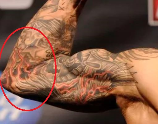 Dustin Poirier Stars and Fire Tattoo