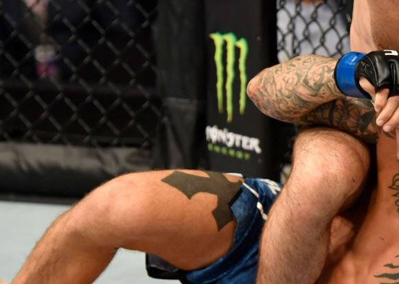 Dustin Poirier Thigh Tattoo
