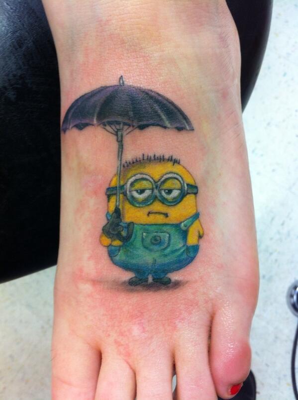 Minion With Umbrella Tattoo On Girl Foot