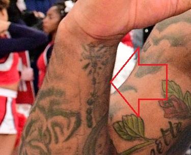 Myles Powell Right Arm Cross Beads Tattoo