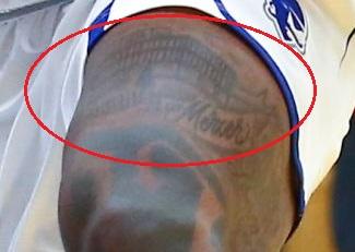 Myles Powell upper Left Thigh Tattoo