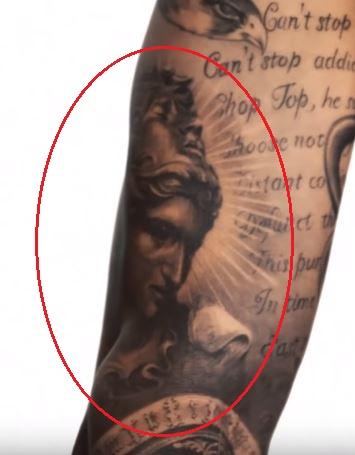 TJ Dillashaw athena tattoo