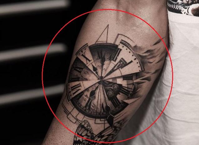 TJ Dillashaw clock tattoo