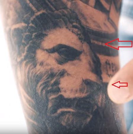 TJ Dillashaw lion tattoo