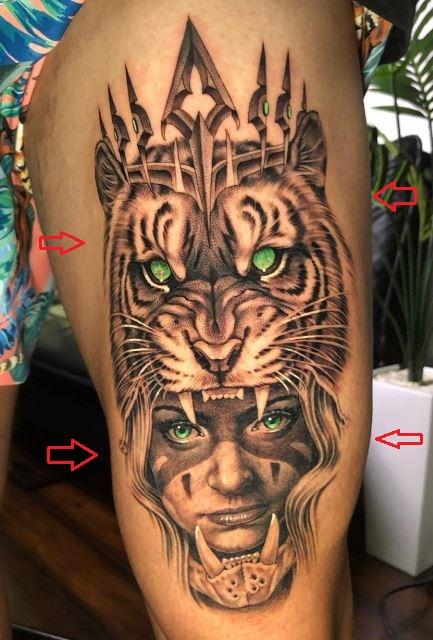 TJ Dillashaw tiger woman tattoo