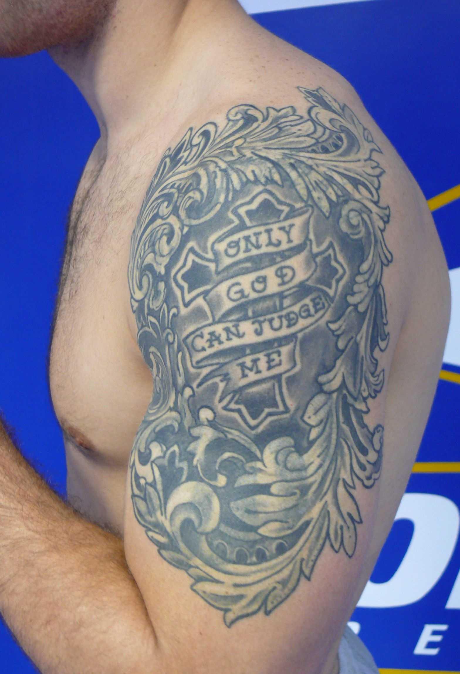 Weidman Left Arm Shoulder Tattoo.jpg